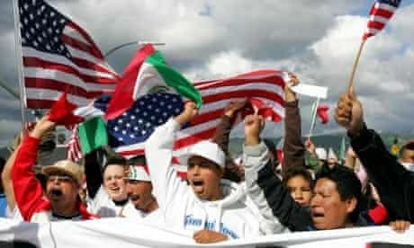 People cheer during a rally for citizenship for illegal immigrants, California, 2006