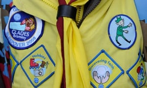 A Brownie shows off her badges