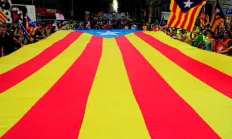 Marchers carry a Catalan flag during a pro-independence rally in Barcelona, in September.