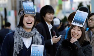 Apple fans queue for the iPad mini
