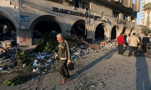 Palestinians inspect the damage after an Israeli air strike in Gaza City.