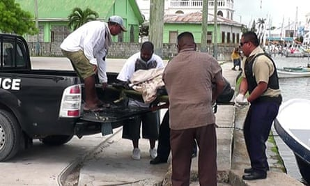 Gregory Faull's body is removed by detectives in Belize following his death.