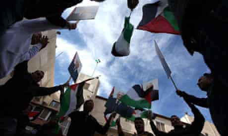 Palestinians hold posters of Mahmoud Abbas at a rally supporting the UN bid