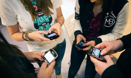 Pupils using mobiles