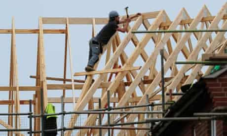 A roofer at work on houses being built in Derbyshire