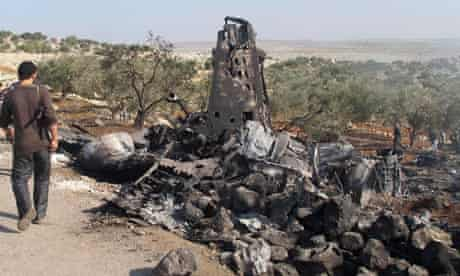 A Syrian warplane shot down by rebels in Syria
