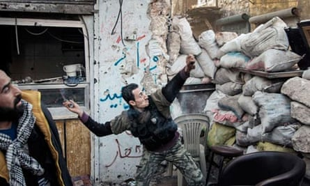 Syrian rebel fighter throws a grenade