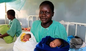 Millicent Owuor, 20, with her newly born twin boys Barack and Mitt