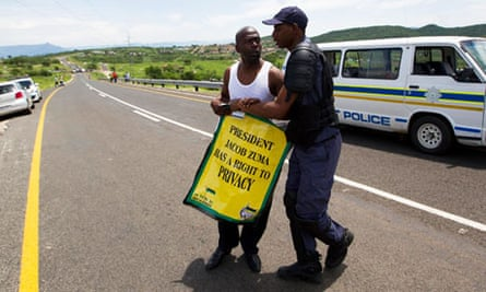 A police officer and a Zuma supporter
