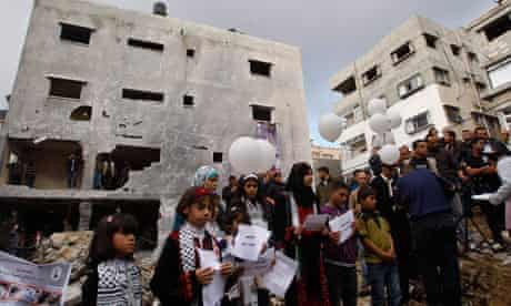 Palestinians release balloons at the site of the bombed Dalou family home