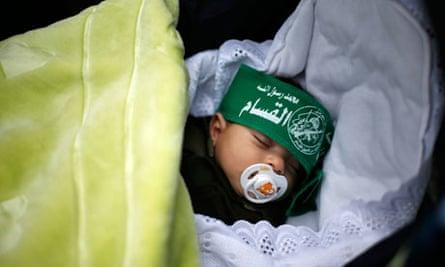 A Palestinian baby wearing a Hamas headband