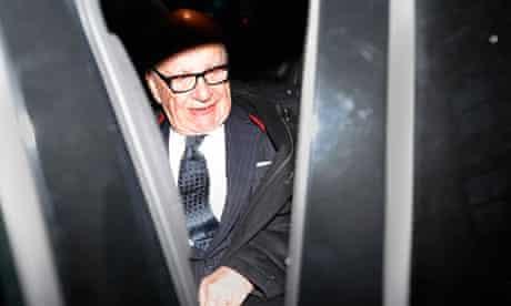 Media mogul Rupert Murdoch leaves his Fifth Avenue home in New York