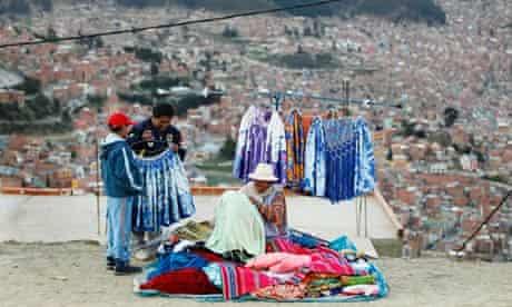 An Aymara woman sells clothes in El Alto, Bolivia