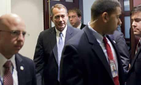 John Boehner leaves a meeting with House Republicans