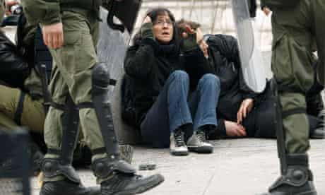 Greece strikes: Demonstrators are detained by riot police