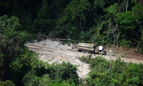 A logging truck enters a deforested area on the outskirts of Novo Progresso, Brazil