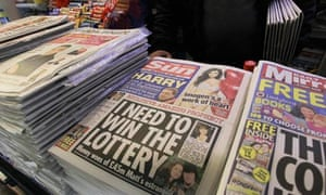 The Sun on sale in London on Saturday as police arrested five senior journalists