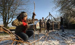 Preparing a hazel stick to build a hurdle at Plump Hill wilderness centre, Gloucestershire