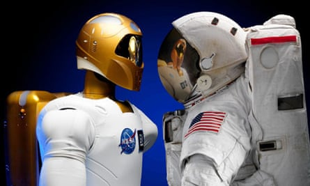 Robonaut facing off with an astronaut suit in the Johnson Space Center in Houston, Texas
