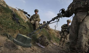 US soldiers check for land mines and IEDs in Kandahar