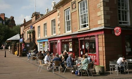 Carlisle shoppers relax with a coffee at the old town hall.