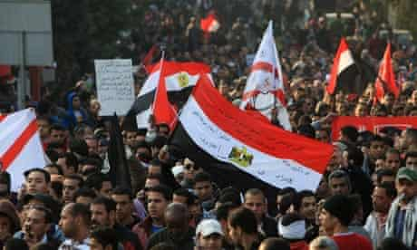Egyptians march in cairo after football riot