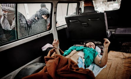 A wounded member of the Free Syrian Army