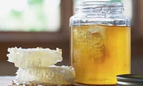 Honeycombs and a jar of honey