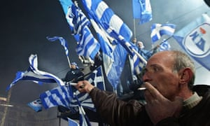 Greek protesters wave flags in Athens