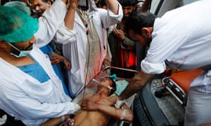 An Afghan protester receives treatment at a hospital