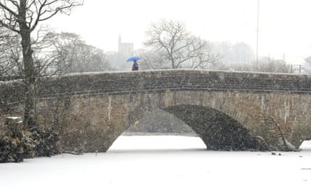 A woman battles through snow in Hawes, Yorkshire. Rural retirement is harder than city folk expect