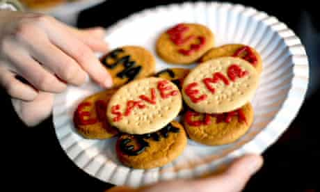 Students from William Morris 6th Form in Hammersmith hand out 'Save EMA' biscuits at Westminster