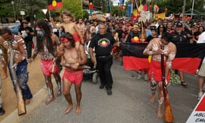 Indigenous and other protesters interrupt an Australia Day awards ceremony in Canberra.
