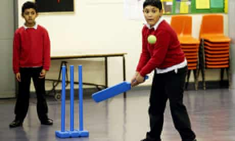 Pupils of Old Palace primary school playing cricket inddors
