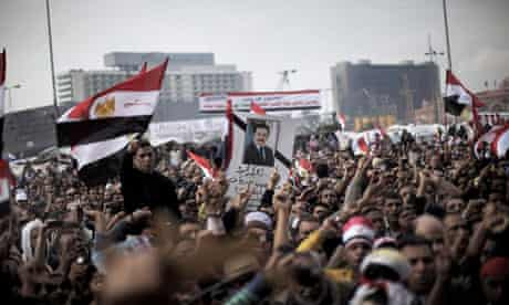 Egyptian anti-government demonstrators stage a symbolic funeral for journalist Ahmed Mohammed Mahmud