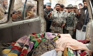 Afghan residents with bodies of shooting victims