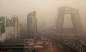 Heavy pollution surrounds the China Central TV building (right) in Beijing on 18 January, 2012