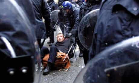 A protester is dragged away by riot police on Oxford Street on 1 May 2001