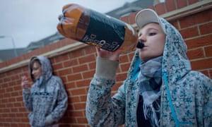 Teenage girls smoking and drinking