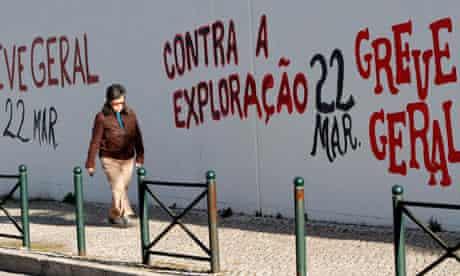 Graffiti in Lisbon reads 'Against the exploitation, general strike 22 March'.