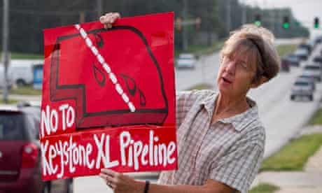 A protester objects to the Keystone XL pipeline