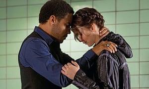 Lenny Kravitz and Jennifer Lawrence in The Hunger Games.
