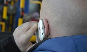 A man talks on an HTC smartphone in Copenhagen