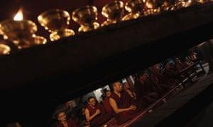 Tibetan monks attend a memorial
