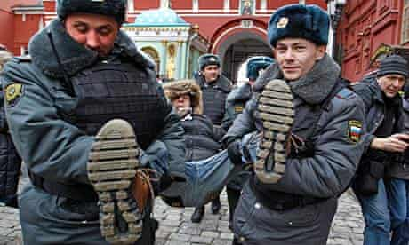 Police detain a protester outside Red Square, Moscow.