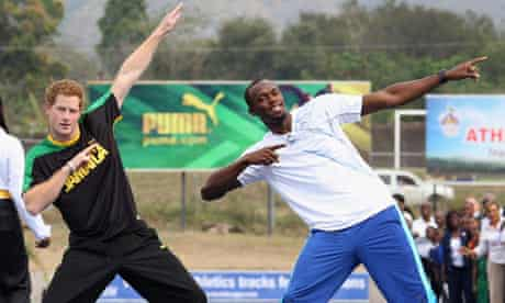 Groovy … Harry horses around with Usain Bolt