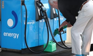 man filling petrol can from fuel pump