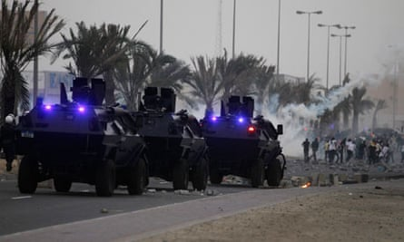 Riot police fire tear gas at protesters after a funeral in Salmabad, Bahrain