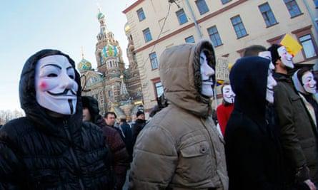 Demonstrators attend a protest against Kremlin policies and vote rigging in St Petersburg