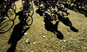 The silhouettes of cyclists on Clapham Common, cyclists taking part in the London-Brighton Bike Ride